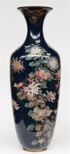 An impressive enamelled vase decorated with flowers , H 116 cm