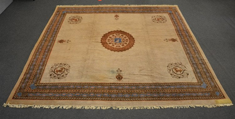 A Tibetan rug, floral decorated, the roundels with mythical animals, 427 x
