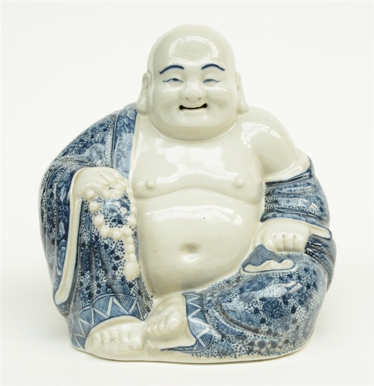 A Chinese blue and white decorated laughing Buddha, marked, H 17 cm