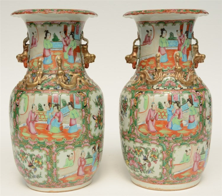 A pair of Chinese Canton vases with relief decorations, H 35,5 cm (one vase
