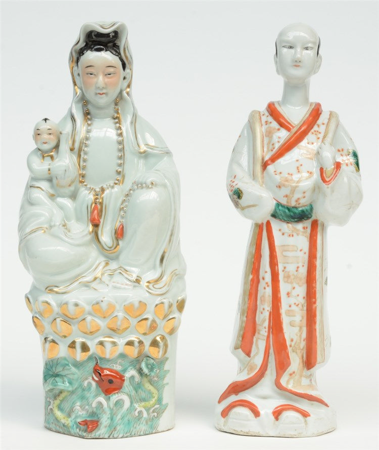 A Chinese polychrome decorated figure of a Guanyin with child sitting on a