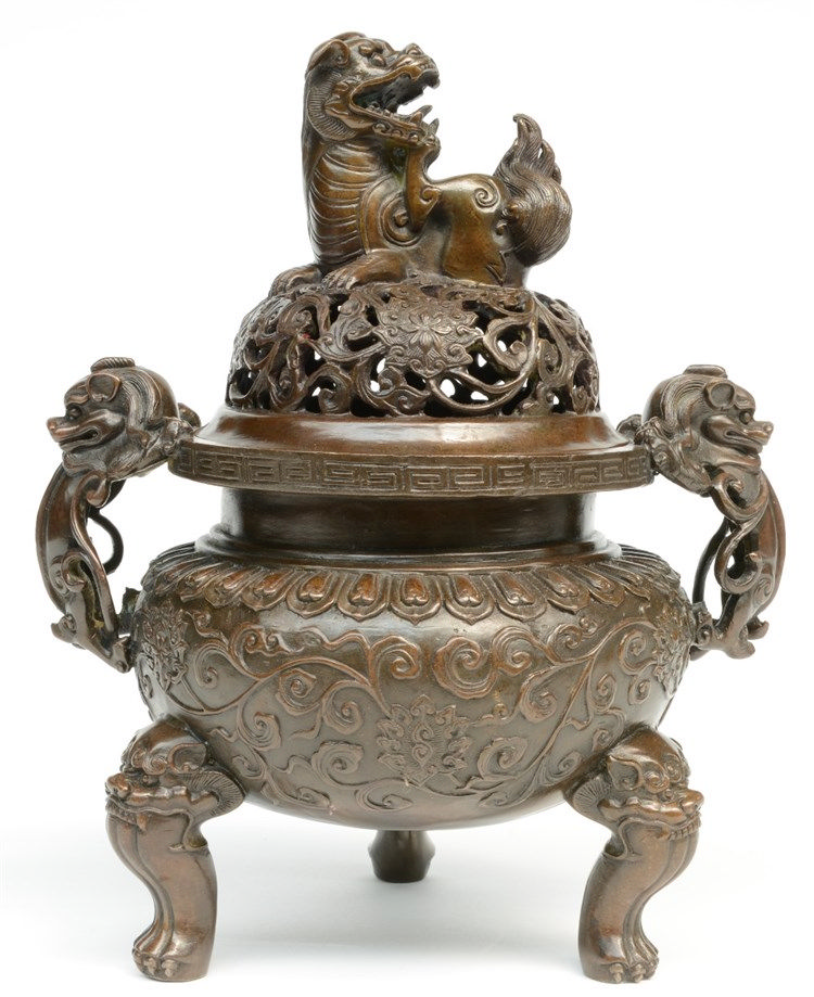 A Chinese bronze incense burner, relief moulded with mythological animals,