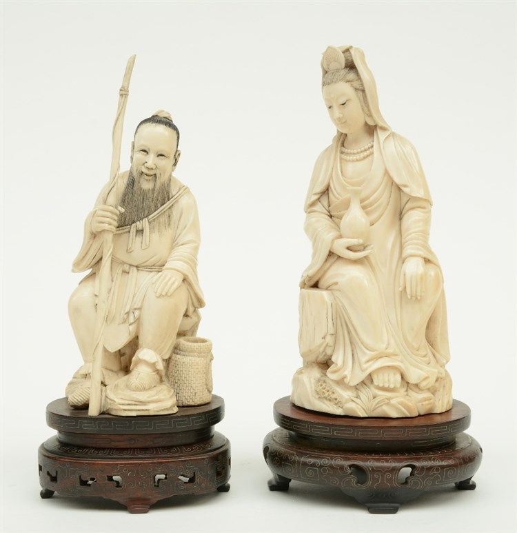 A Chinese ivory Guanyin seated on a rock, late Qing-dynasty, on a damascene