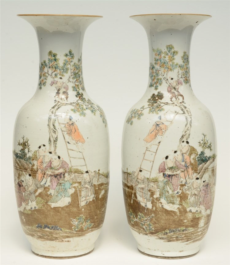 A pair of Chinese polychrome decorated vases, painted with an animated scen
