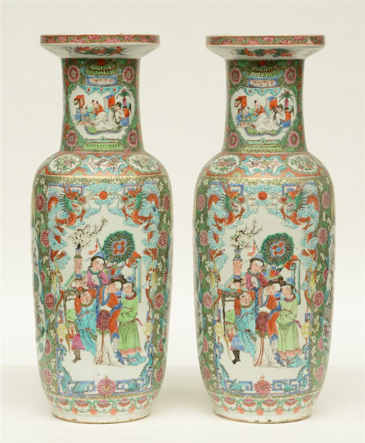 A pair of Chinese 19thC famille rose rouleau vases decorated with animated
