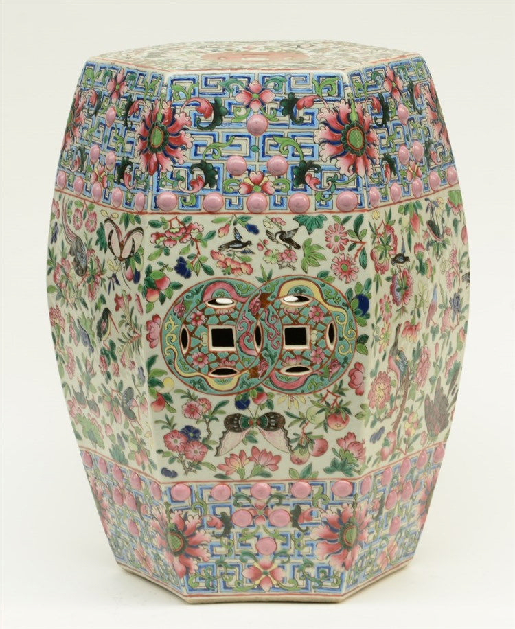 A Chinese famille rose garden seat decorated with birds, butterflies and dr