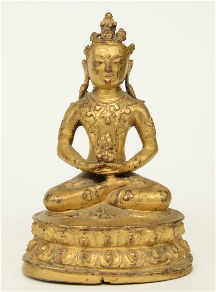 An Oriental gilt bronze Buddha, H 14,5 cm