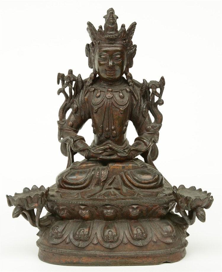 An Oriental bronze Buddha, H 22 cm