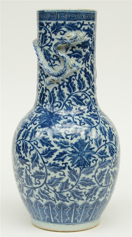 A Chinese blue and white and relief decorated vase, 19thC, H 44,5 cm (crack