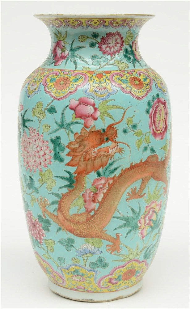 A Chinese turquoise ground famille rose vase, decorated with dragons, 19thC
