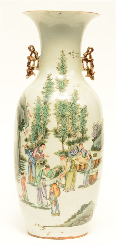 A Chinese polychrome vase, decorated with literati in a landscape, H 58,5 c