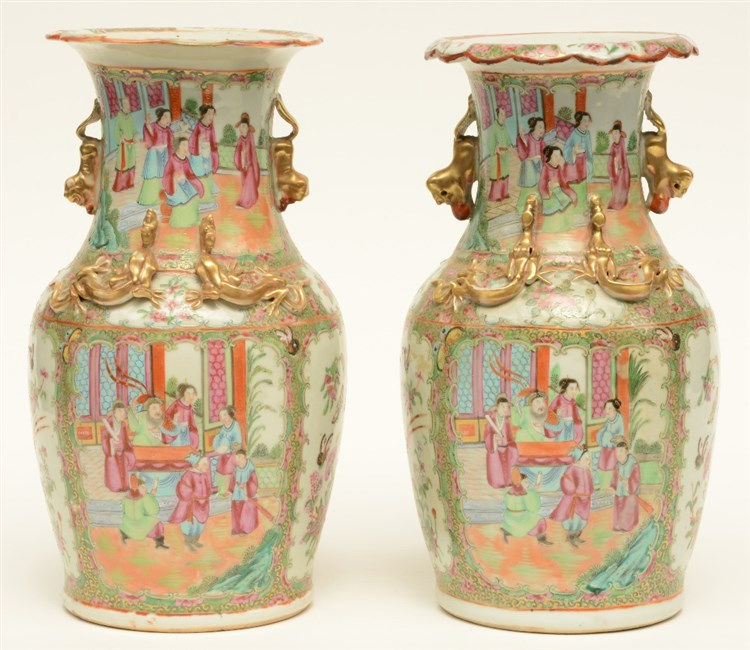 A pair of Chinese Canton vases, relief decorated, 19thC, H 35 cm (one vase