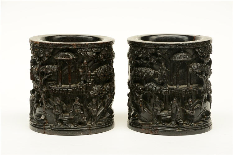 A pair of Chinese wooden pots, overall alto relievo decorated with an anima