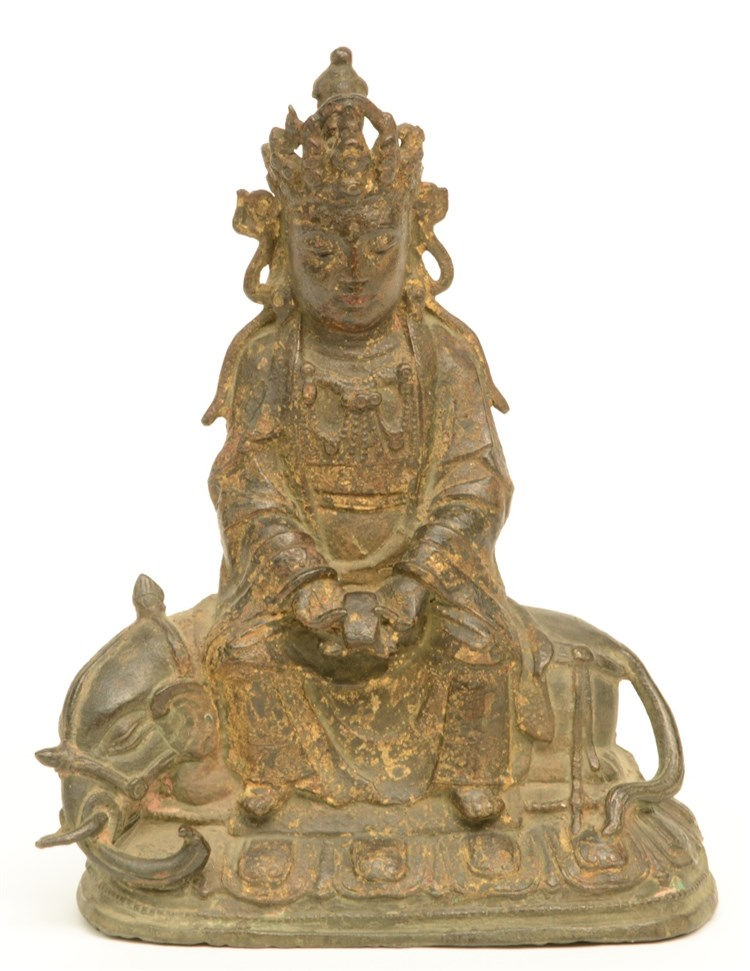 A Chinese gilt bronze Buddha, sitting on an elephant, 18thC, H 20,5 (traces