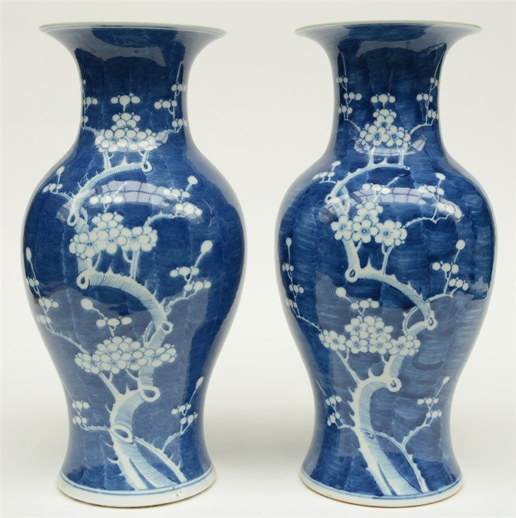 A pair of Chinese blue and white decorated vases painted with prunus blosso