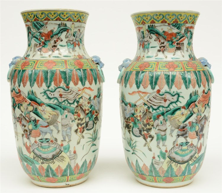 A pair of Chinese famille verte vases, overall decorated with warriors, 19t