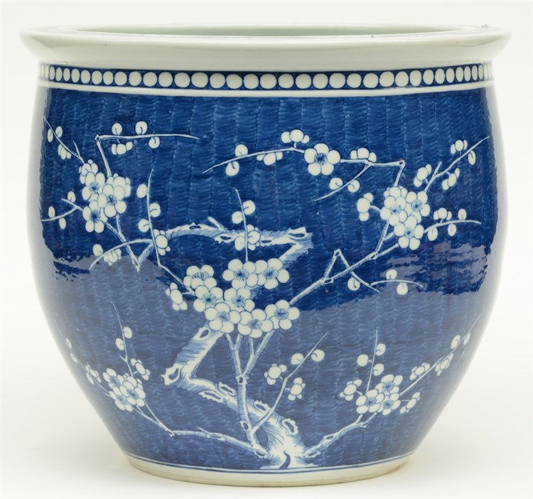 A Chinese blue and white cache-pot decorated with prunus blossoms, H 36 - D