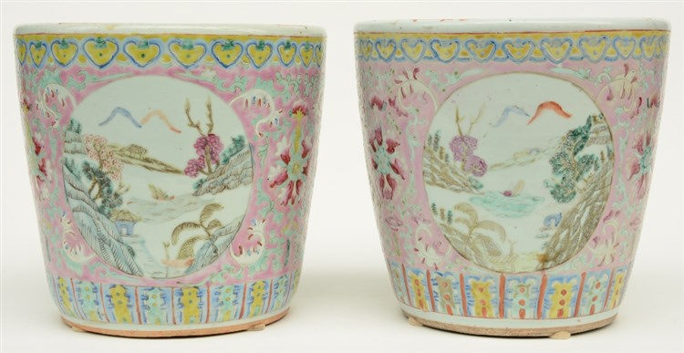 A pair of Chinese pink ground polychrome cache-pots, the roundels decorated