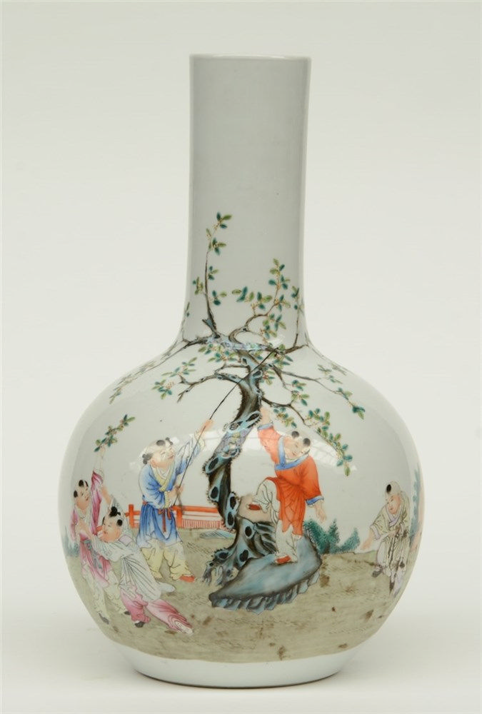 A Chinese polychrome bottle vase, decorated with children playing in a gard