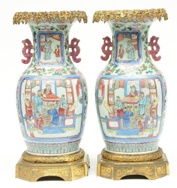 A pair of Chinese famille rose vases, decorated with animated scenes and gi