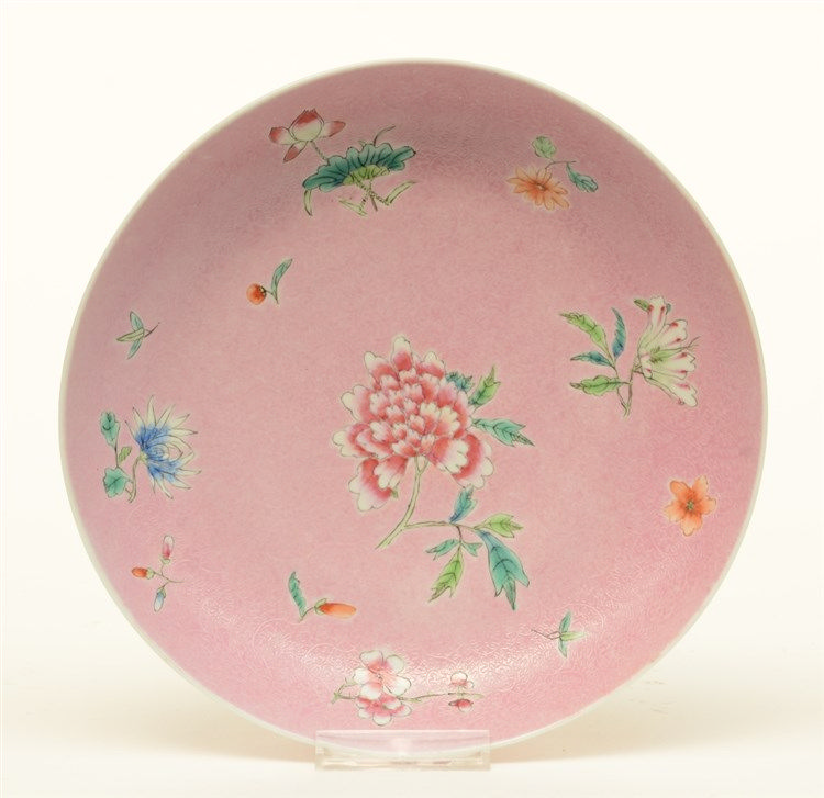 A Chinese pink ground relief moulded dish, decorated with flowers, marked J