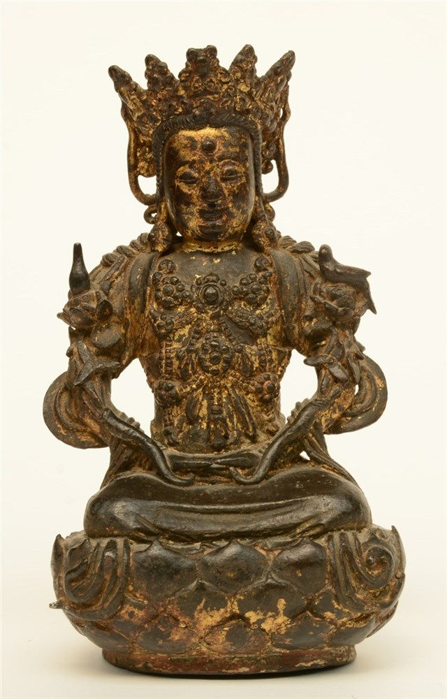 A Chinese gilt bronze Buddha, with polychrome traces, probably Ming, H 20 c