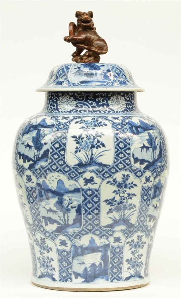 A large Chinese blue and white vase with cover, decorated with flowers and