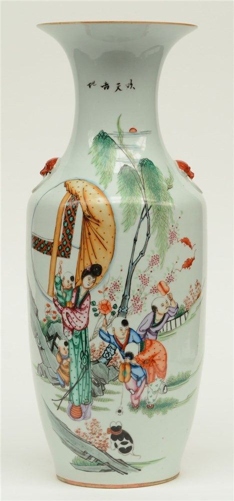 A Chinese vase, polychrome decorated with children playing in a garden, H 5
