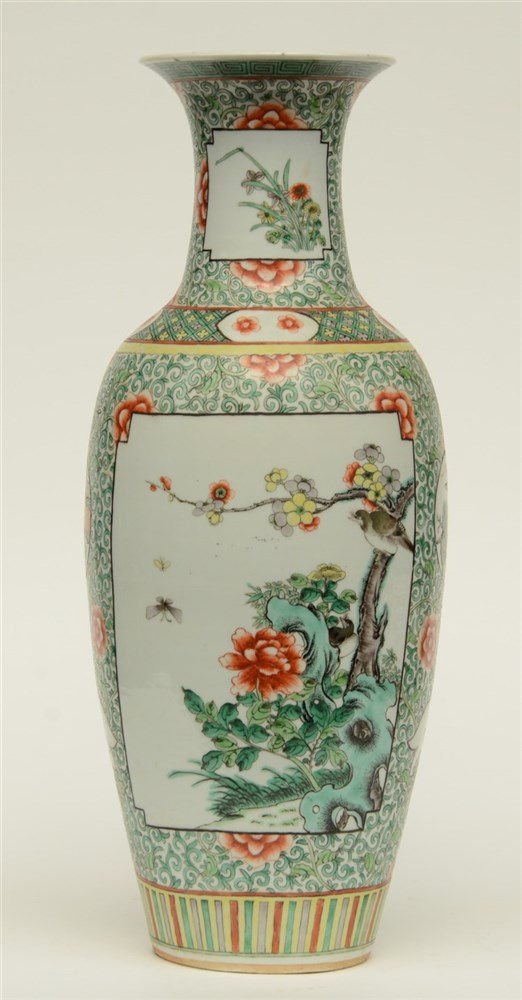 A Chinese polychrome vase decorated with flower branches, landscapes and fl
