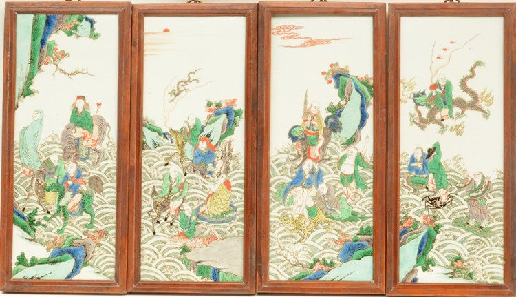Four Chinese famille verte plaques in frame, decorated with animated genres