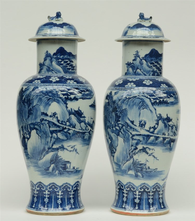 A pair of Chinese blue and white baluster shaped vases with cover, overall