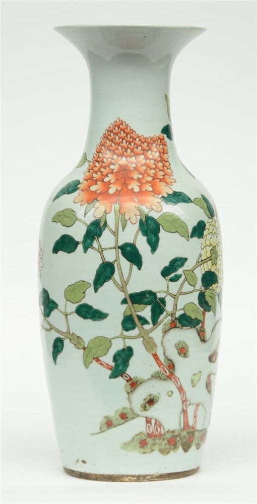 A Chinese polychrome vase decorated with a butterfly and flower branches, H