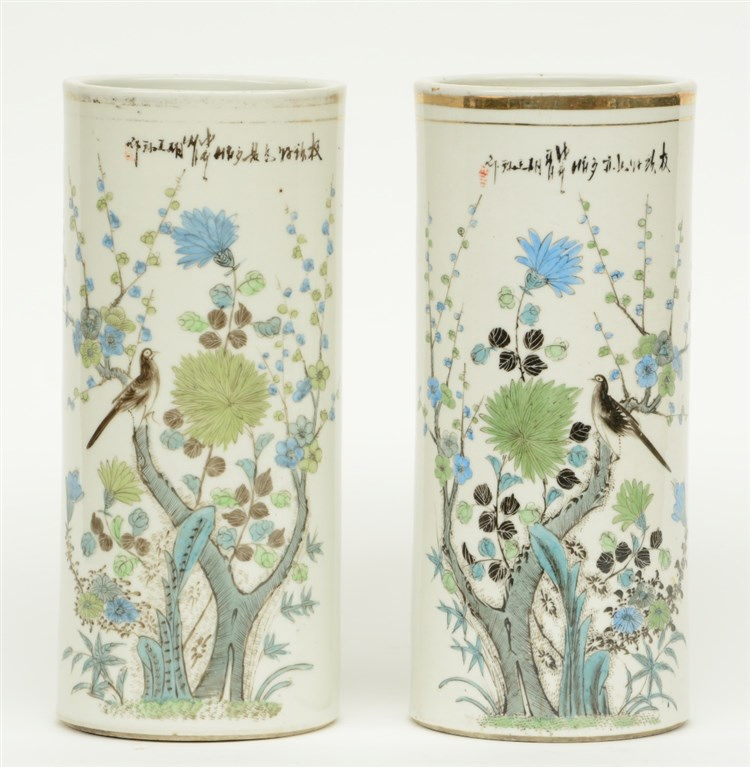 A pair of Chinese cylinder shaped vases, polychrome decorated with a bird a