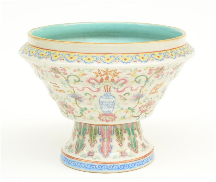 A Chinese famille rose stem cup, decorated with symbols and floral motifs,