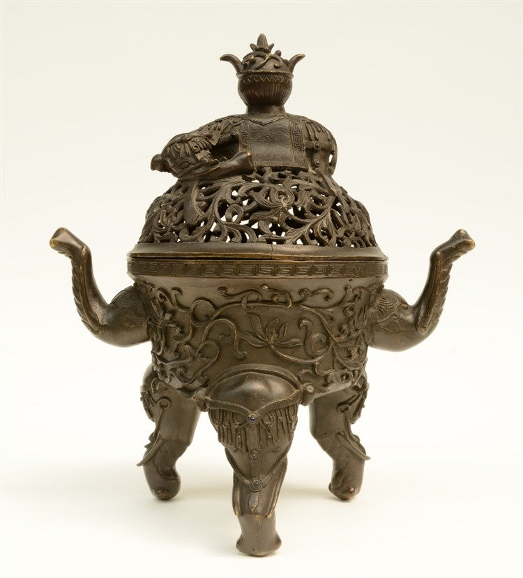 A Chinese bronze incense burner, elephant relief decorated, Ming, 17thC, H