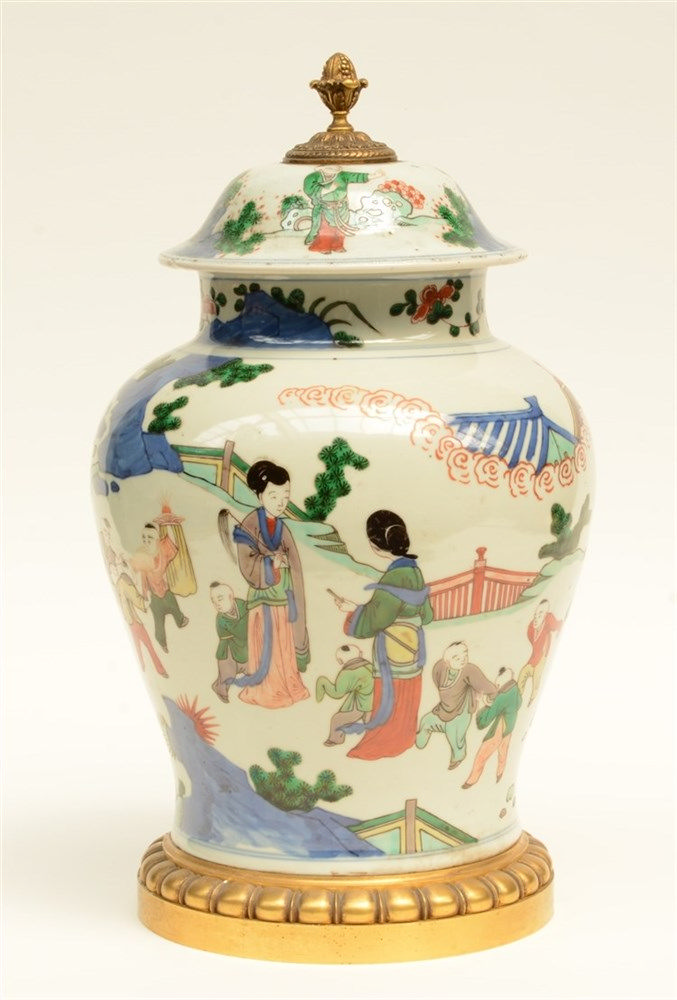 A Chinese wucai vase with cover, decorated with children playing in a garde