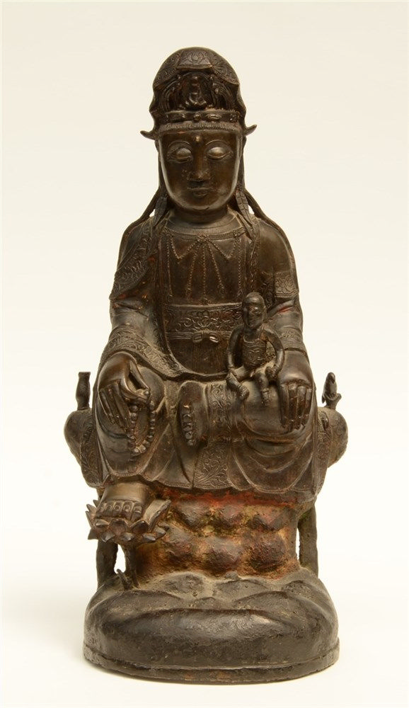 A Chinese bronze Guanyin, Ming, 17thC, H 48 cm (traces of polychromy, damag