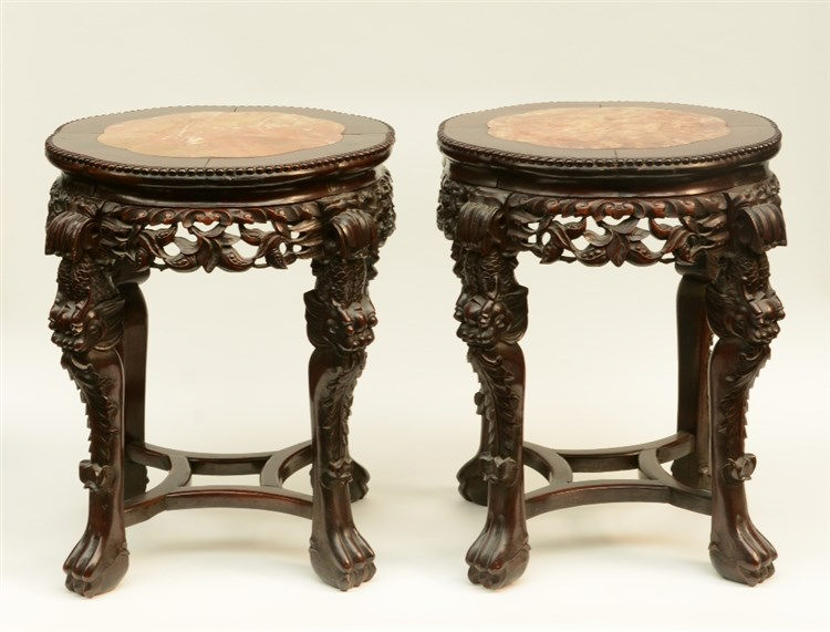 A pair of Chinese carved hardwood stools with marble top, H 58 - 58,5 - Dia