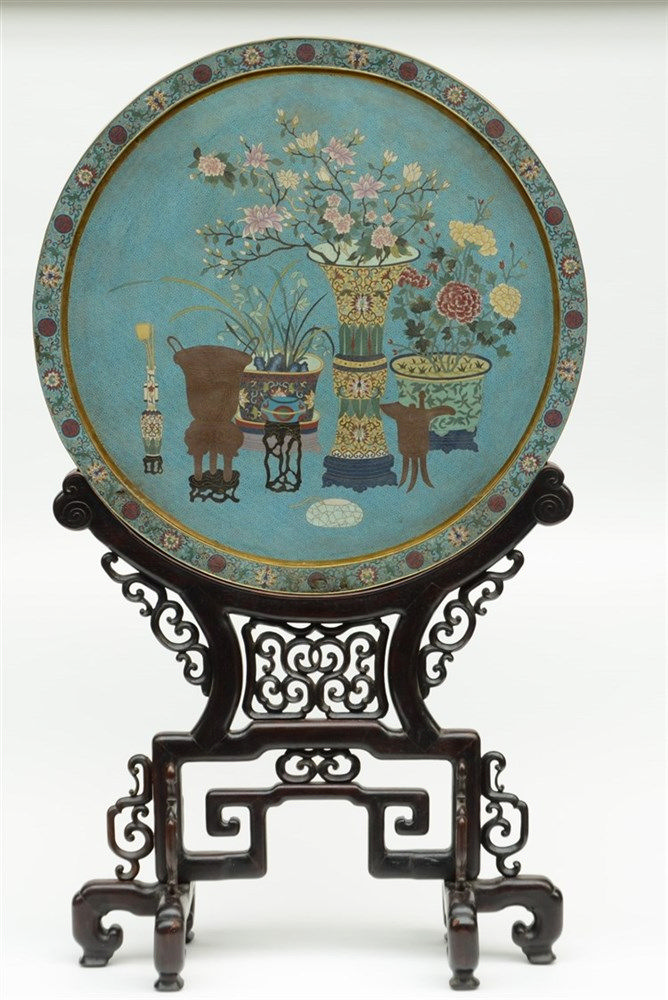 An imposing Chinese round cloisonné plaquette, mounted on matching wooden b