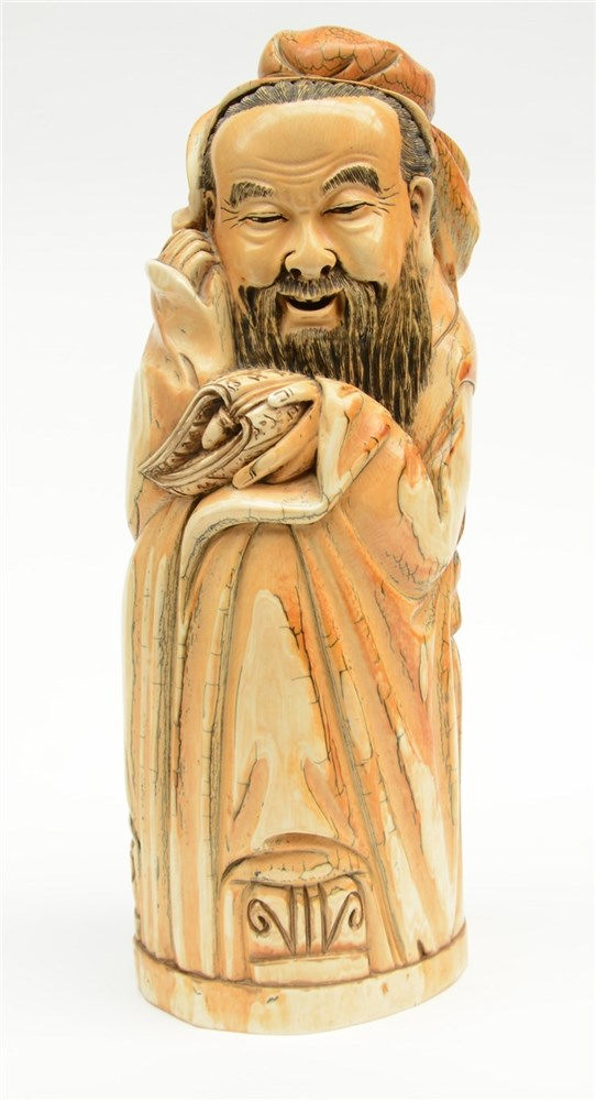 A Chinese 'mammoth' ivory sculpture depicting a sage, scrimshaw decorated,