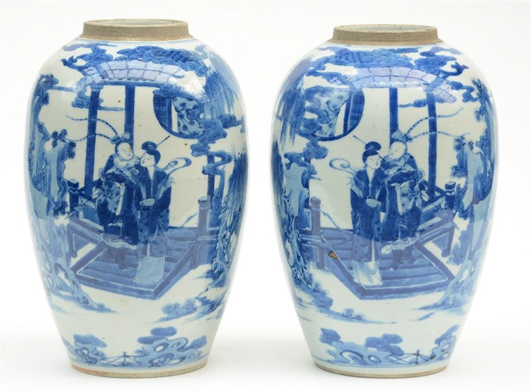 A pair of Chinese blue and white vases, decorated with an animated garden s