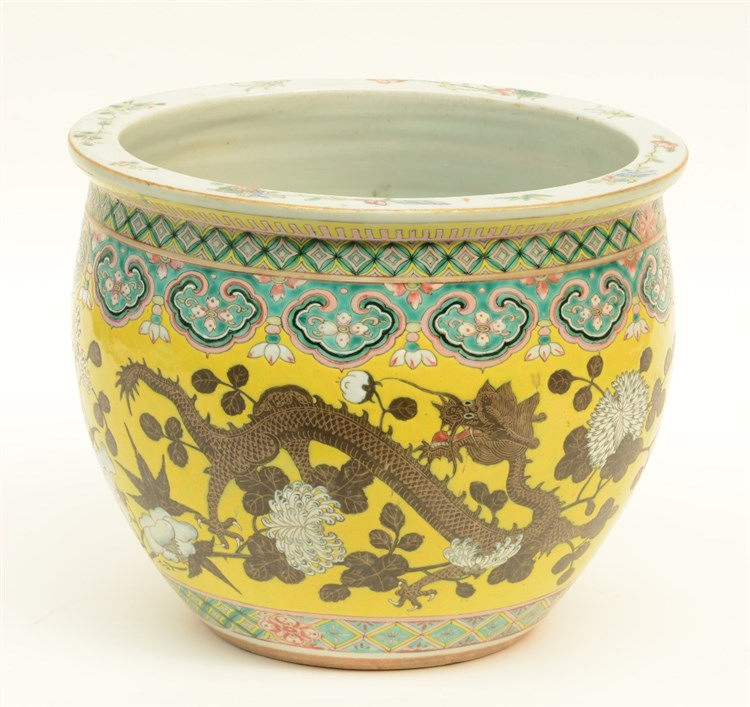 A Chinese yellow-ground polychrome cachepot, painted with dragons and flowe