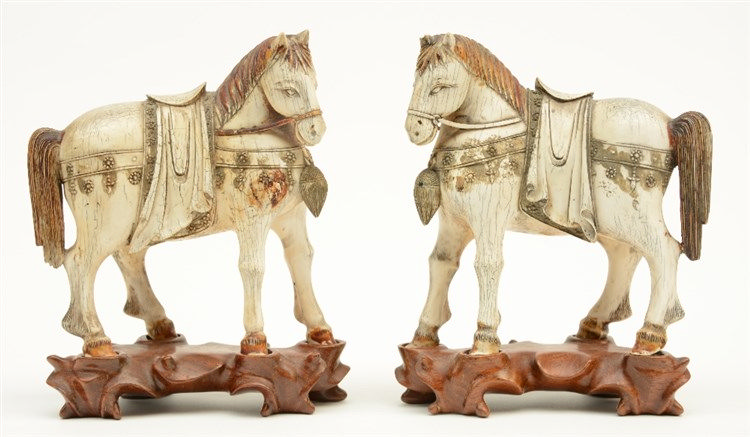 A pair of Chinese ivory horses, polychrome and scrimshaw decorated on match