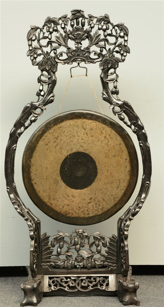 A Chinese bronze gong in a carved hardwood frame, H 128 - W 66 cm