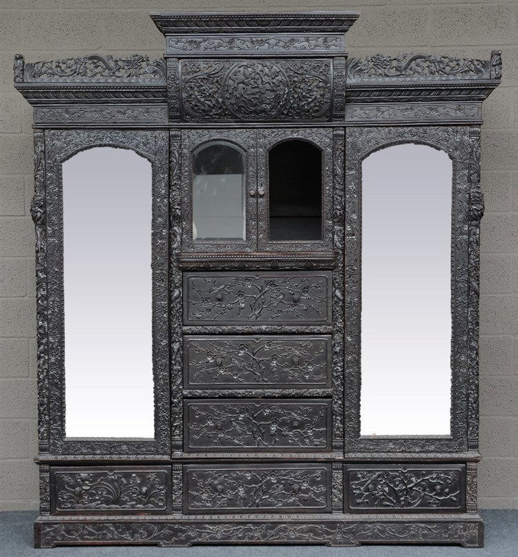 An Impressive Chinese hardwood display cabinet, richly carved with dragons
