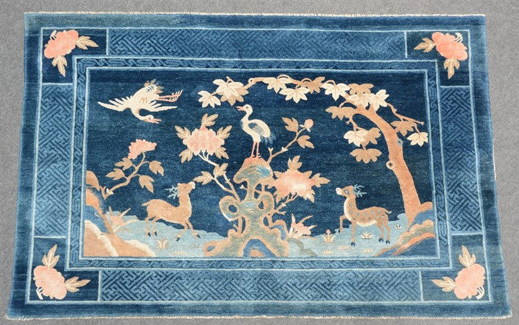 A Chinese wool rug decorated with deers, birds and flower branches, 134 x 2