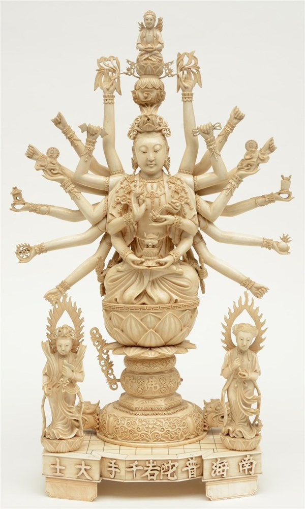 A Chinese ivory 100-armed seated Guanyin and two other goddesses, on a matc