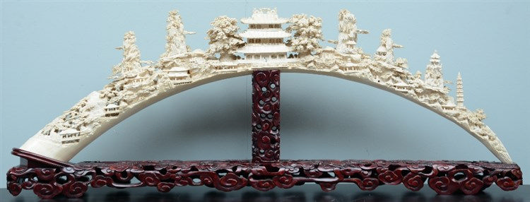 An exceptional Chinese richly carved ivory tusk, depicting various temples