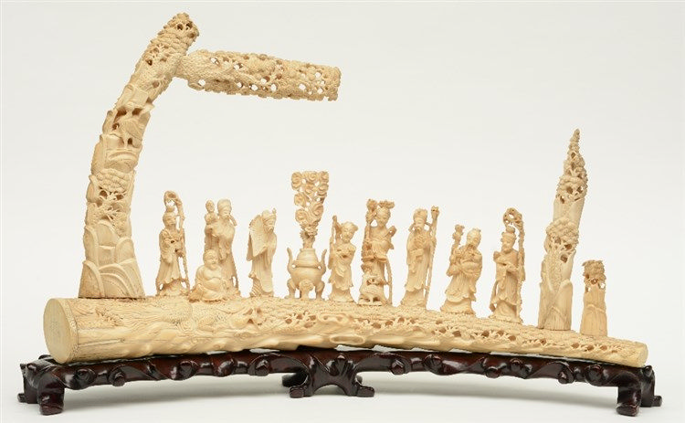 An impressive Chinese ivory sculpture, depicting the Eight Immortals, marke