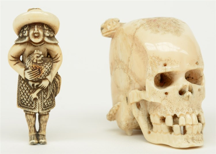 An exceptional Japanese ivory okimono of a skull with a snake, Edo period,